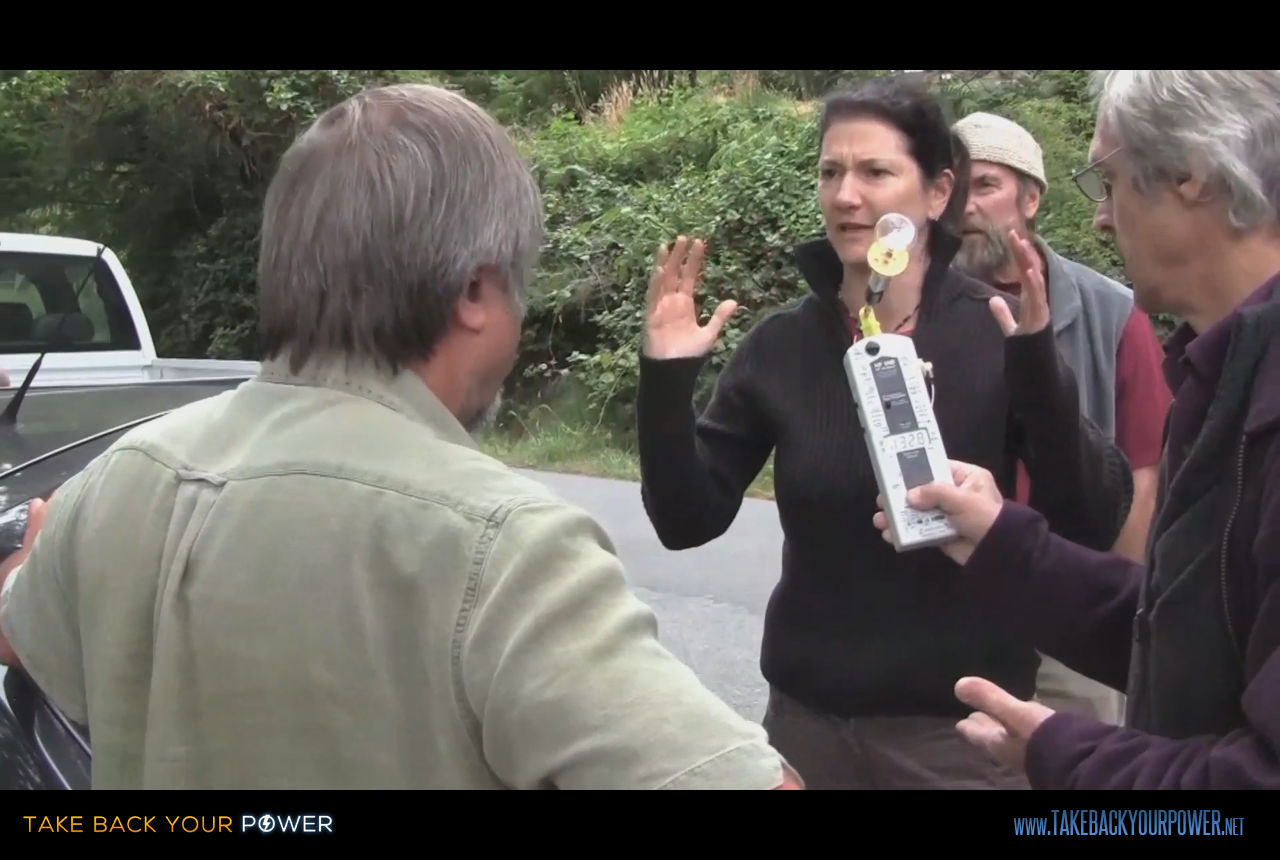 A stand-off between a community and a smart meter installer (scene from Take Back Your Power)